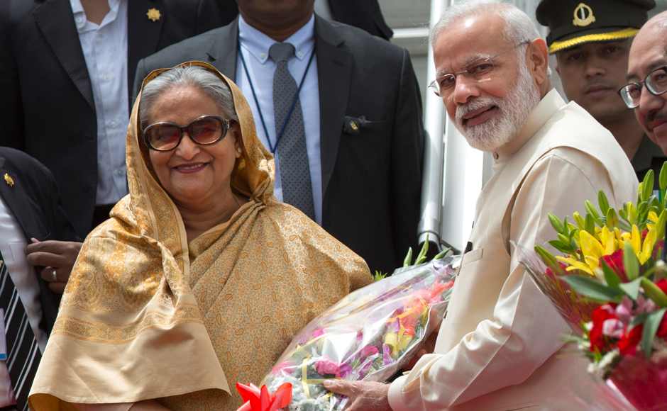 Bangladeshi Prime Minister Sheikh Hasina, left, and her Indian counterpart Narendra Modi pose for the media as Hasina is greeted by Modi upon her arrival in New Delhi, India, Friday, April 7, 2017. Hasina is on a four-day state visit to India. (AP Photo/Manish Swarup)