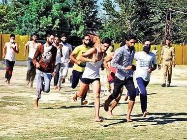 Kashmiri youth run during an army recruitment rally. PTI