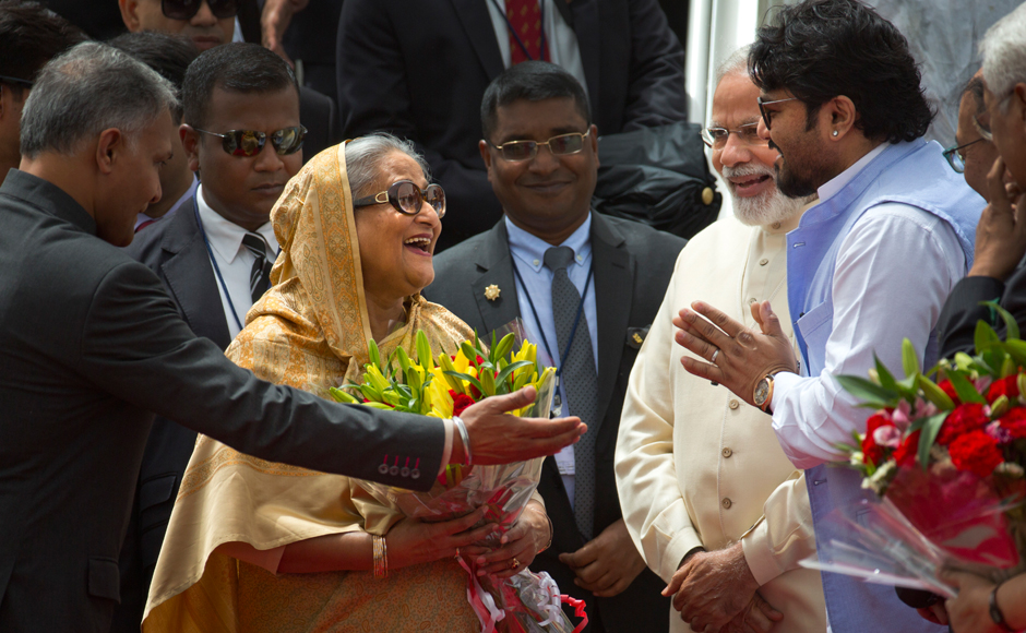 Indian protocol officer, left, introduces Indian Junior Minister for Heavy Industries and Public Enterprises, Babul Supriyo, right, to Bangladeshi Prime Minister Sheikh Hasina as Indian Prime Minister Narendra Modi, second right, watches upon her arrival in New Delhi, India, Friday, April 7, 2017. Hasina is on a four day state visit to India. (AP Photo/Manish Swarup)