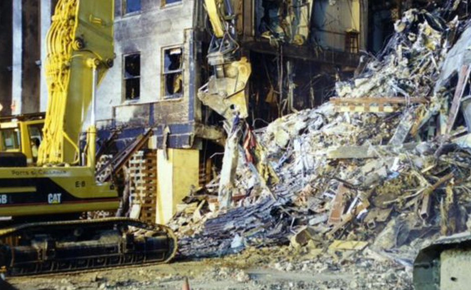 """An excavator appears to remove a shredded American flag in a photo labelled """"Pentagon Exterior"""""""