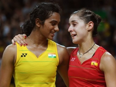Carolina Marin with PV Sindhu during their gold medal match at Rio Olympics. AFP