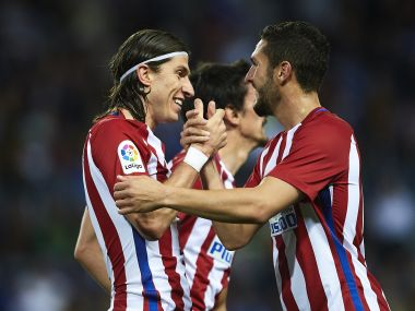Filipe Luis of Atletico Madrid celebrates after scoring their second goal against Malaga. Getty Images