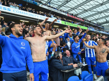 Brighton and Hove Albion players celebrate after beating Wigan and securing promotion to the Premier League. Getty Image