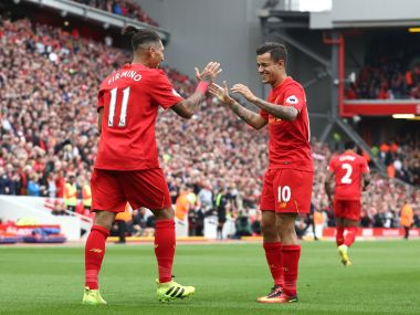 File photo of Liverpool's Philippe Coutinho celebrating with Roberto Firmino. Getty