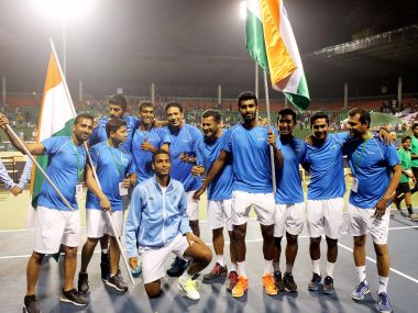 Indian team celebrates after winning the doubles match to clinch the Davis cup against Uzbekistan. PTI