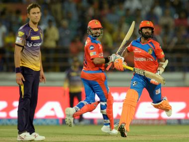 Gujarat Lions' Dinesh Karthik (R) and Suresh Raina (C) run between the wickets against KKR. AFP