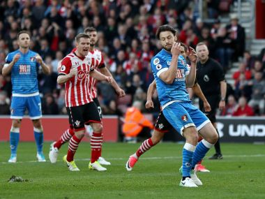 Harry Arter of Bournemouth reacts as he misses a penalty against Southampton. Getty