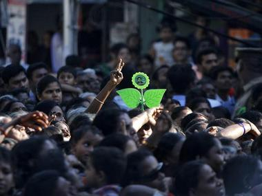 Supporters of All India Anna Dravida Munetra Khazhgam (AIADMK) attend an election campaign rally addressed by J. Jayalalithaa, chief minister of India's Tamil Nadu state and chief of AIADMK, in the southern Indian city of Chennai April 19, 2014. Around 815 million people have registered to vote in the world's biggest election - a number exceeding the population of Europe and a world record - and results of the mammoth exercise, which concludes on 12 May, are due on 16 May. REUTERS/Babu (INDIA - Tags: POLITICS ELECTIONS)