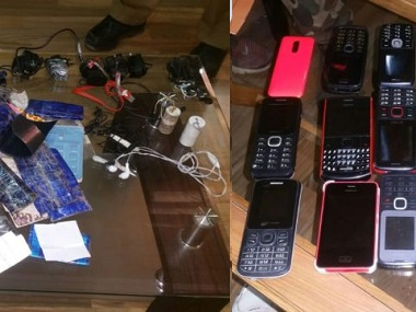 Cell phones and other gadgets recovered during raid in Baramulla district jail. Image courtesy: Sameer Yasir