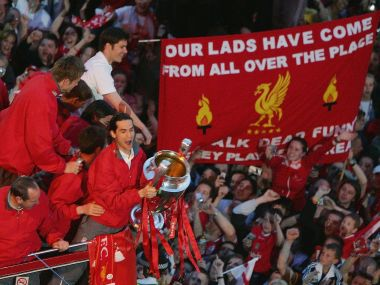 Luis Garcia lifts the Champions League trophy as the Liverpool team ride on an open top bus. Getty Images