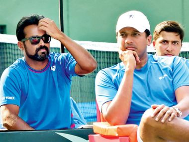 India's Leander Paes (left) and non-playing captain Mahesh Bhupathi during the David Cup. PTI