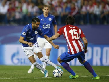 Leicester City's Riyad Mahrez, left, attempts to take the ball past Atletico's Stefan Savic. AP