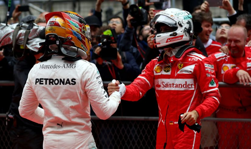 Race winner Lewis Hamilton of Mercedes GP shakes hands with second placed finisher Sebastian Vettel of Ferrari. Getty