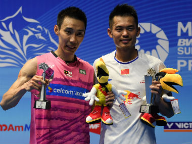 Lee Chong Wei and Lin Dan pose with their titles at the Malaysia Open in Kuching. AFP