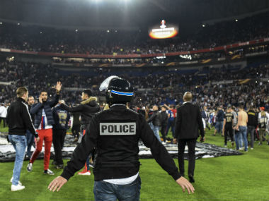 Police stand on the pitch after Besiktas' and Lyon's supporters fought before the UEFA Europa League first leg quarter final football match between Lyon (OL) and Besiktas. AFP