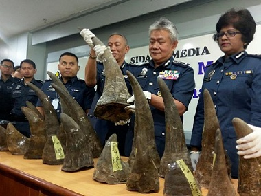 Customs officials with the rhino horns that were seized at Kuala Lumpur airport. Reuters