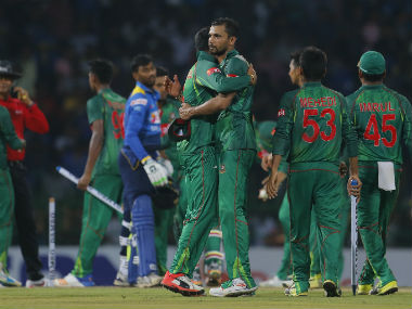 Bangladesh players congratulate Mashrafe Mortaza after winning the second T20I in Colombo. Getty Images