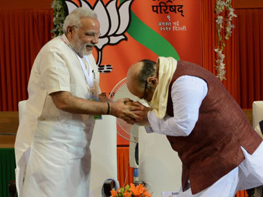 BJP chief Amit Shah seeks blessing from Prime Minister Narendra Modi. AFP