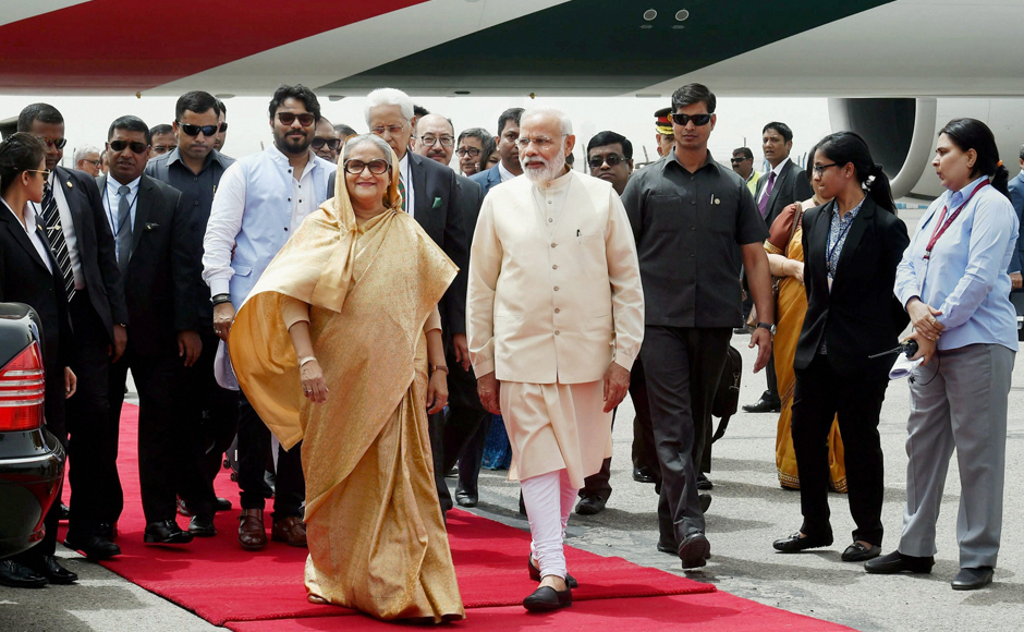 Prime Minister Narendra Modi welcomes Bangladesh Prime Minister Sheikh Hasina as she arrives at the Delhi Airport for her four-day visit to India. PTI Photo by Atul Yadav (PTI4_7_2017_000019B)