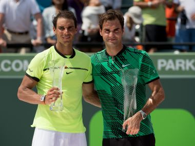Rafael Nadal and Roger Federer pose with their trophies after Federer won the Miami Open title. Getty