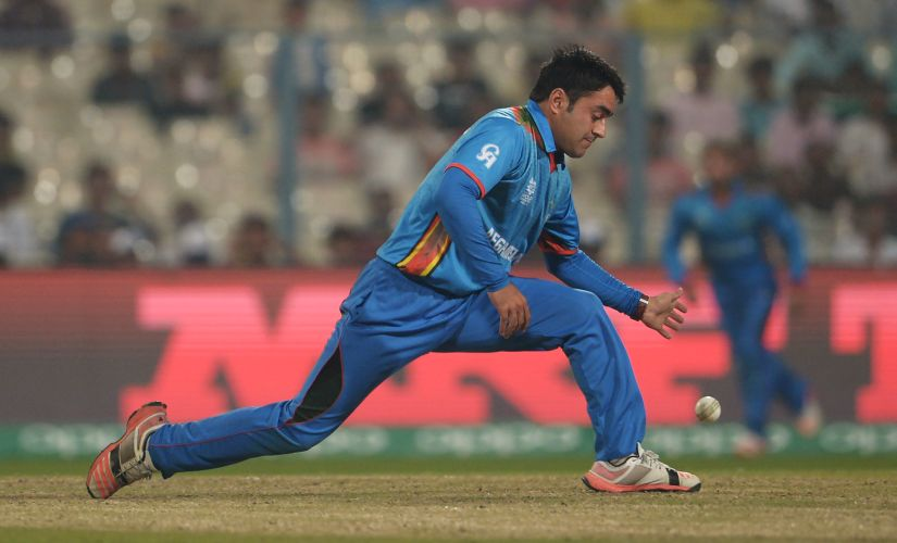 Afghanistan's Rashid Khan fields the ball during the World T20 tournament. AFP
