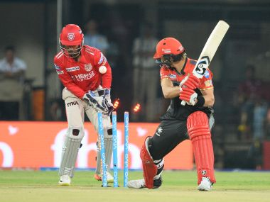 Royal Challengers Bangalore's Shane Watson is bowled duing the match against Kings XI Punjab. AFP