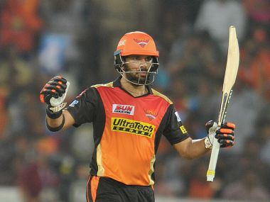 Sunrisers Hyderabad's Yuvraj Singh raises his bat after scoring fifty runs during the IPL opener. AFP