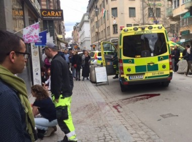 Blood smeared on the street after a truck crashed into a Stockholm department store. AP