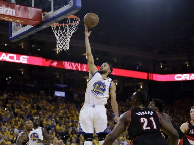 Golden State Warriors' Stephen Curry (30) scores against the Portland Trail Blazers. AP
