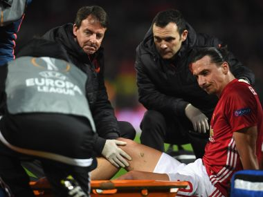 An injured Zlatan Ibrahimovic is given assistance during the Europa League quarter-final. Getty