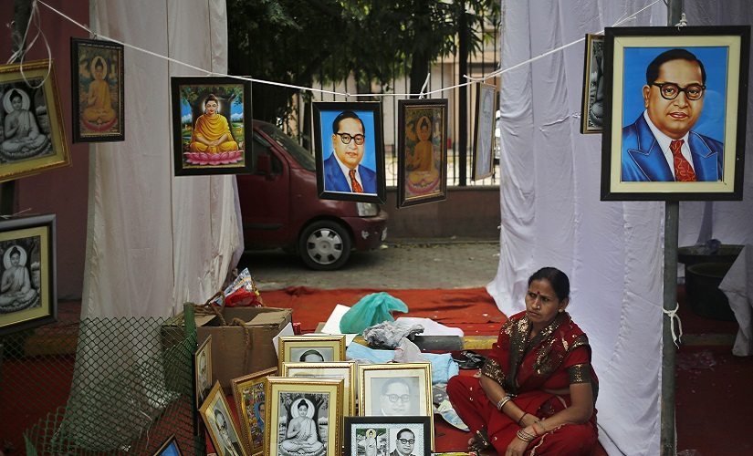A vendor sells portraits of BR Ambedkar on a pavement in New Delhi. Reuters