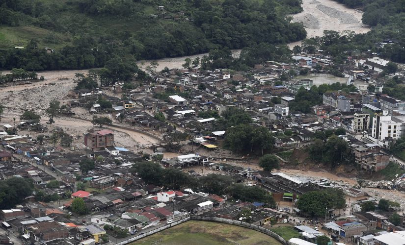 This handout photo released by the Colombia Presidential Press Office, shows an aerial view of a portion of Mocoa in Colombia after an avalanche of water from an overflowing river swept through the city as people slept. AP