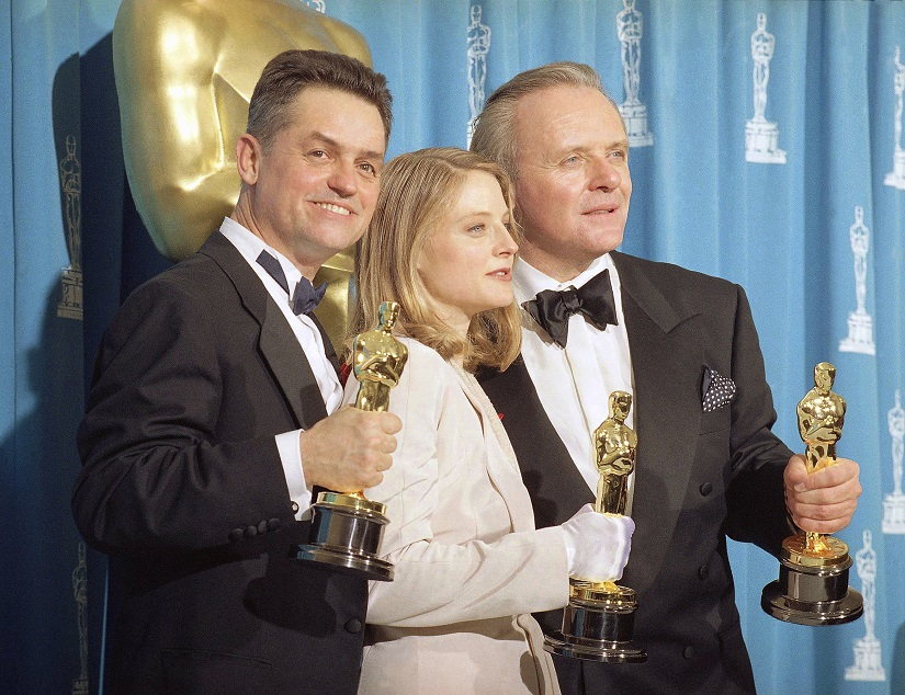 "FILE - In this May 31, 1992 file photo, director Jonathan Demme, left, holds his award for best director, actress Jodie Foster holds her award for best actress, and actor Anthony Hopkins holds his award for best actor for their work on ""Silence of the Lambs,"" at the Academy Awards in Los Angeles. Demme died, Wednesday, April 26, 2017, from complications from esophageal cancer in New York. He was 73. (AP Photo/Reed Saxon, File)"