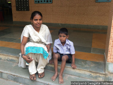 A child with special needs sits next to his mother in the municipal school he attends in Parel, central Mumbai. Some 600,000 special-needs children between six and 13 years of age are out of school at a time when India has almost universal primary school enrolment.