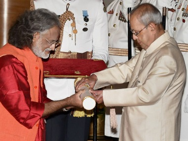 President Pranab Mukherjee felicitates Grammy Award-winner music maestro Pandit Vishwa Mohan Bhatt in New Delhi on Thursday. PTI
