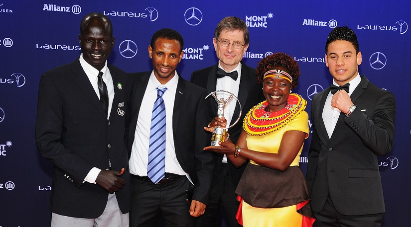 MONACO - FEBRUARY 14: The Winners of the Laureus Sport for Good the Olympic Refugee team pose with their trophy and Laureus Academy Member Tegla Loroupe at the Winners Press Conference and Photocall during the 2017 Laureus World Sports Awards at the Salle des Etoiles,Sporting Monte Carlo on February 14, 2017 in Monaco, Monaco. (Photo by Eamonn M. McCormack/Getty Images for Laureus) *** Local Caption *** Tegla Loroupe