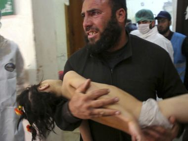 Photo from Tuesday's attack on Syrians. According to reports, Assad government used sarin to kill children, women and men. AP