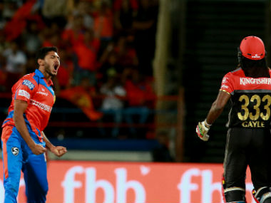 GL's Basil Thampi (L) celebrates the wicket of Chris Gayle against RCB. Sportzpics