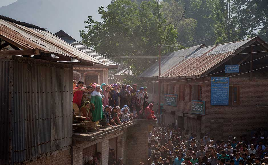 Kashmir unrest Thousands attend Sabzar Bhats funeral amid curfewlike restrictions