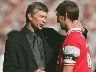Arsenal manager Arsene Wenger congratulates captain Tony Adams after their FA Cup final win in 1998. AFP