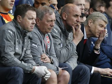 Arsenal manager Arsene Wenger (right) reacts during the match against Tottenham Hotspur. AFP