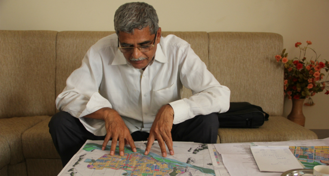 Anumolu Gandhi examines the CRDA plans. Photo - Swati Sanyal Tarafdar for Firstpost