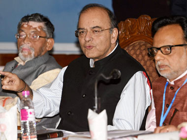 Union Finance Minister Arun Jaitley with MoS Santosh Gangwar and Reneue Secretary Hasmukh Adhia addressing a press conference on the firsrt day of the 14th Goods and Services Tax (GST) Council at SKICC in Srinagar on Thursday. PTI