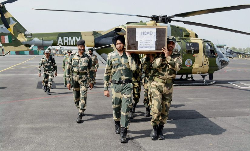 BSF jawans carry the coffin of head constable Prem Sagar, who lost his life in the ceasefire violation by Pakistan at LoC in Krishnagati sector of Poonch district in Jammu on Tuesday. PTI