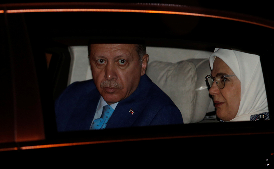 Turkish President Tayyip Erdogan and his wife Emine Erdogan sit inside their car after their arrival at the airport in New Delhi, India, April 30, 2017. REUTERS