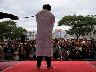 Indonesian men publicly caned for gay sex defying Sharia law in Aceh province