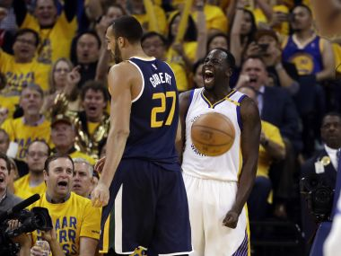 Golden State Warriors' Draymond Green, right, celebrates after scoring against Utah Jazz. AP