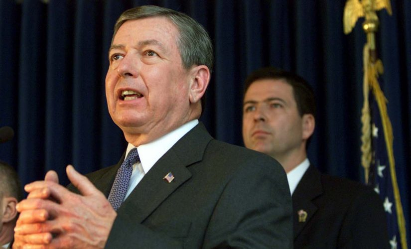 John Ashcroft (L), flanked by James Comey in a file image. Reuters