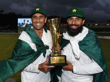 Younis Khan (L) and captain Misbah-ul-Haq (R) celebrate with the series trophy. AFP