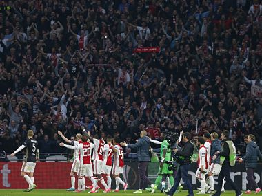 Ajax's players celebrate after the first leg semi final match between Ajax and Olympique Lyon. AP